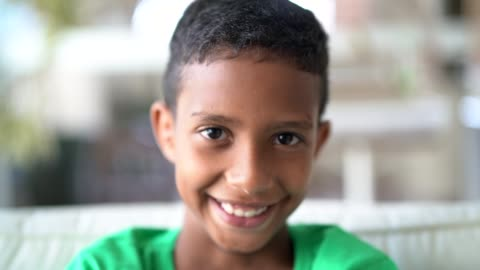 Cute afro boy looking at camera Portrait child stock videos & royalty-free footage