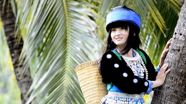 cute asian girl in beautiful hill tribe costume of thailand video