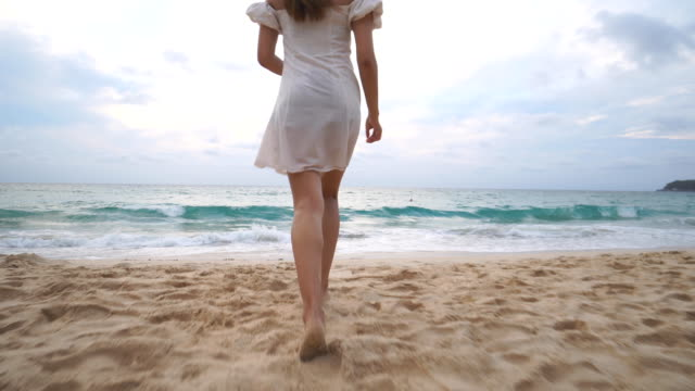 a cute asian girl on the beach in cloudy day - phuket video stock e b–roll