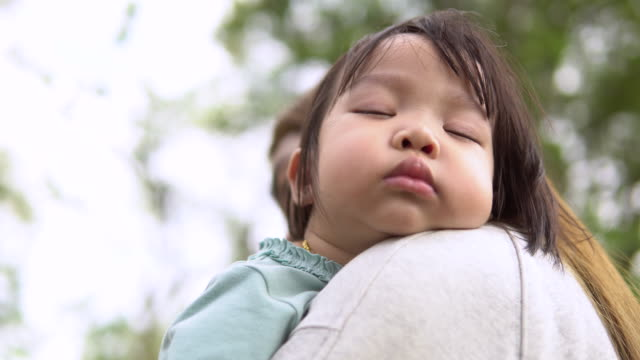 cute asian newborn baby girl sleeping on mother's arm - 2 3 anni video stock e b–roll