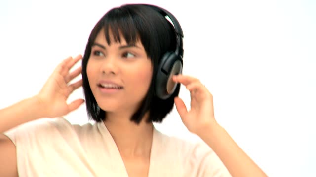 Cute asian woman listening to music video