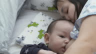 istock Cute baby boy breastfeeding 1253698961