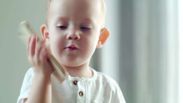 Cute Baby Boy Learning How to Call on the Phone