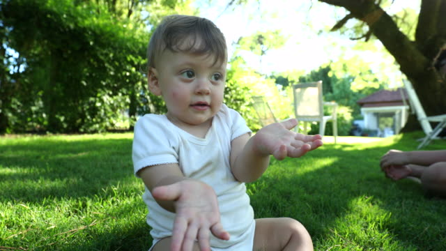 Cute baby gesturing with hand with blank face, Puzzled funny toddler confused