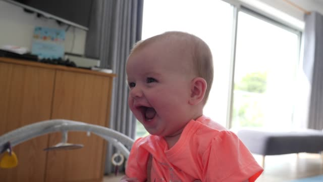 4k: cute baby laughing (slow motion) - soltanto neonati video stock e b–roll