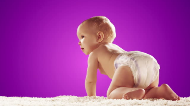Cute baby on white carpet. video