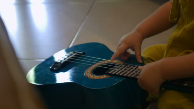 Best Baby Guitar Stock Videos and Royalty-Free Footage - iStock