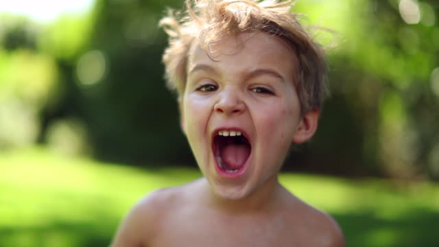 Cute baby toddler yelling in slow-motion 120fps. Adorable infant shouting outside Cute baby toddler yelling in slow-motion 120fps. Adorable infant shouting outside facial expression stock videos & royalty-free footage