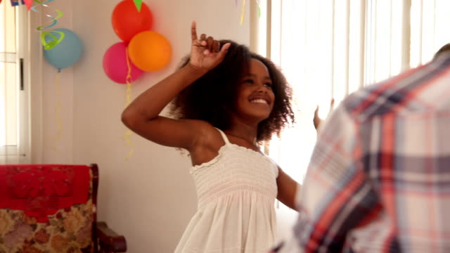 Cute Black Girl Smiling At Camera And Playing With Balloons video