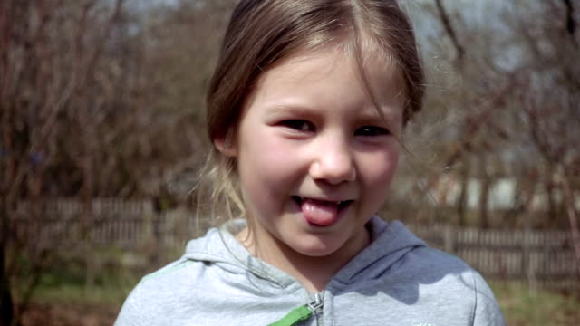 Cute blond little girl puts out her tongue video