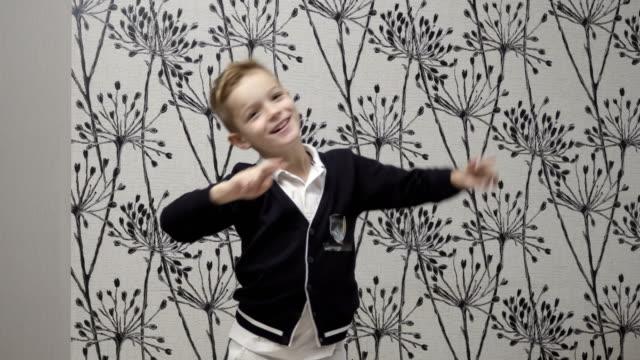 Cute boy fools at home video