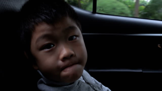 Cute boy making a face in car Cute boy making a face in car land vehicle stock videos & royalty-free footage