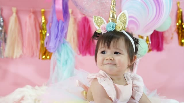 Cute Caucasian toddler baby girl at birthday party, smiling and clapping hands. Happy celebration moment with fancy decorations Cute Caucasian toddler baby girl at birthday party, smiling and clapping hands. Happy celebration moment with fancy decorations princess stock videos & royalty-free footage