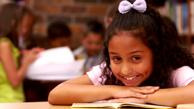 Cute child at school smiling at the camera video