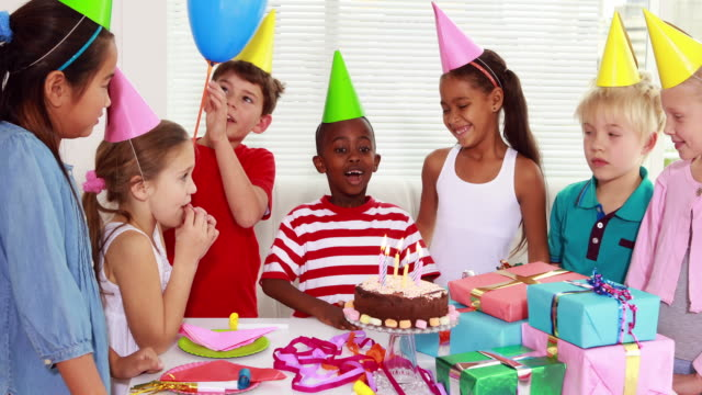 Cute children celebrating a birthday together video