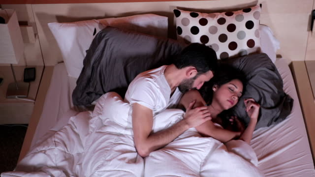 Cute couple laying in bed video