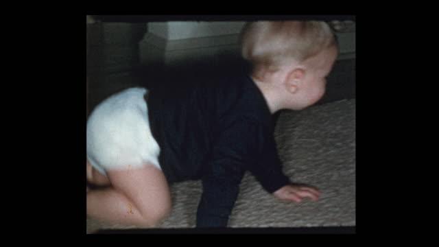 cute curious baby boy crawling and standing up - hotel reception filmów i materiałów b-roll
