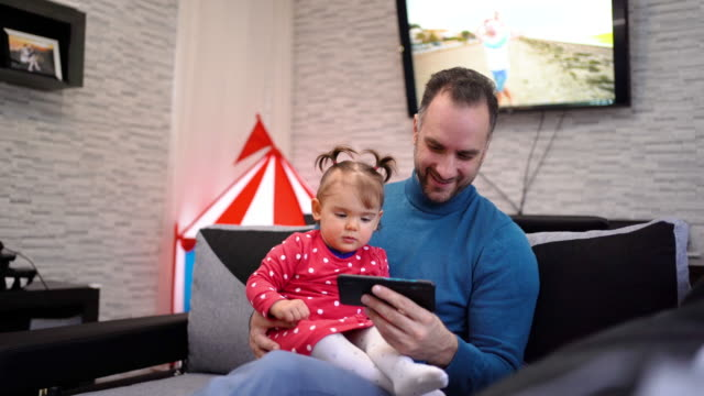 Cute daughter and her father having funny time