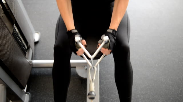 cute fit girl doing exercises on the simulator video