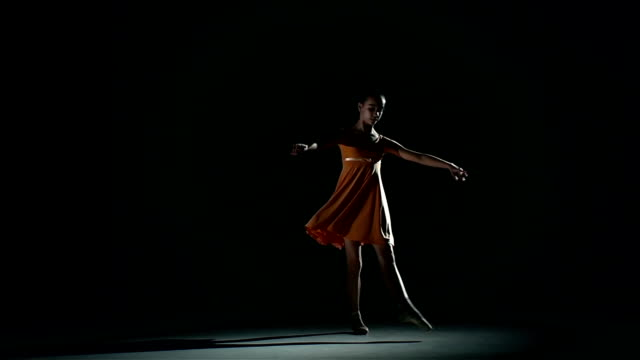 cute girl ballerina in dress large hall. slow motion video