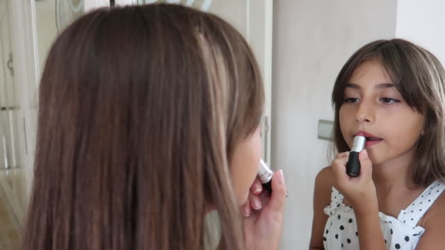 Cute girl fixing her make up