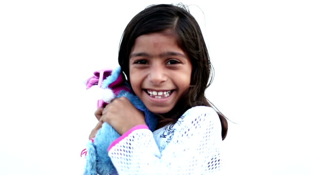 Cute girl hugging each other her teddy Cheerful  innocent poor little girl playing with teddy bear on white background doll stock videos & royalty-free footage