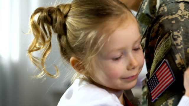 Cute girl hugging female soldier closeup, child missing mother family separation