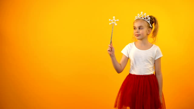 Cute girl in fairy outfit looking to camera, little princess playing magic wand Cute girl in fairy outfit looking to camera, little princess playing magic wand princess stock videos & royalty-free footage