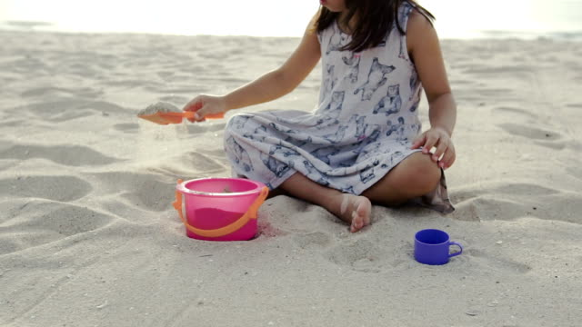 Cute girl is play and enjoy on the beach. video