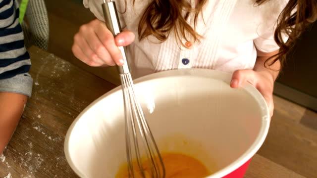 Cute girl preparing a cake video