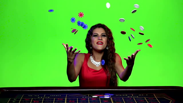 Cute girl rejoices victory at the poker table. Slow motion video
