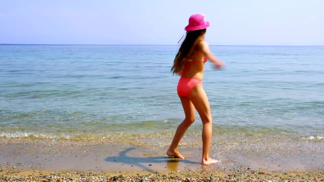 Cute girl spinning. Cute girl spinning on the beach. HD. swimwear stock videos & royalty-free footage