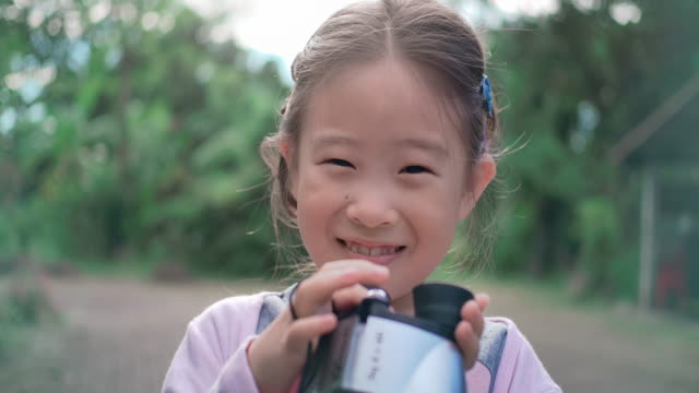 SLO MO Cute happy children girl using binoculars