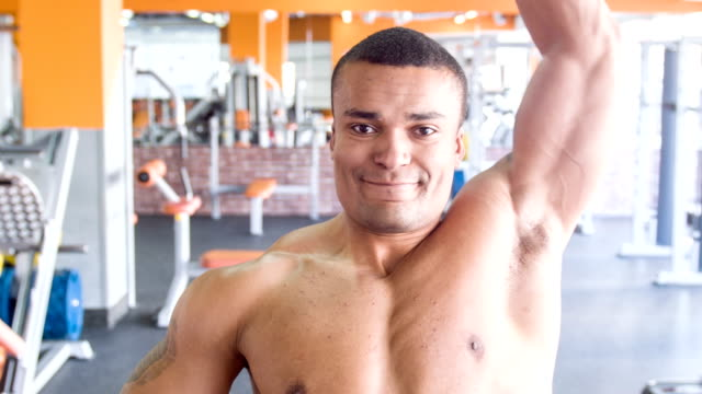 Cute heavy-weight sportsman is exercising with dumbbell video