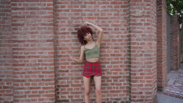 Cute Hispanic Redhead woman