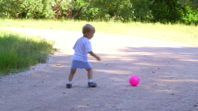 Cute kid runs and kicks the ball video