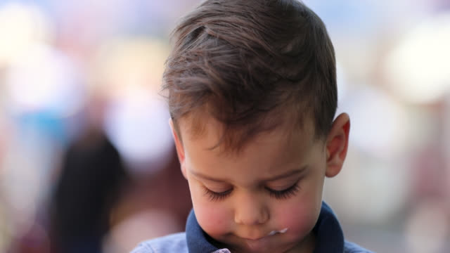 Cute Little Boy Eating Ice Cream