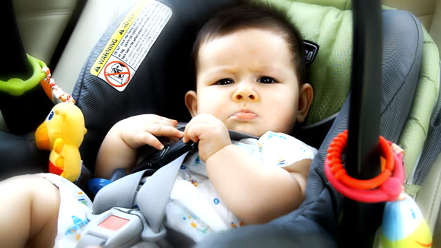 Cute little boy in car seat video