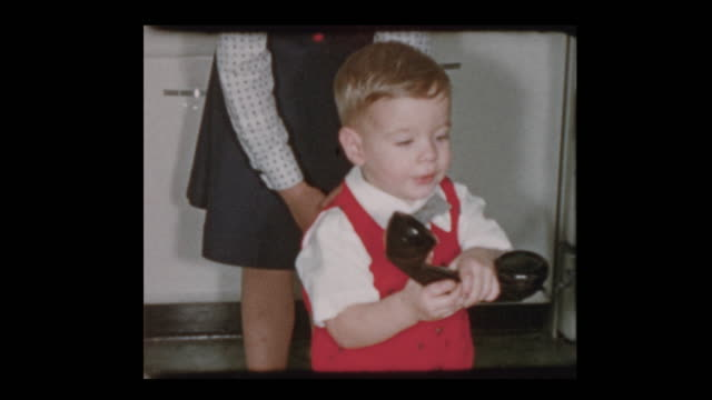 1955 Cute little boy on old fashioned telephone