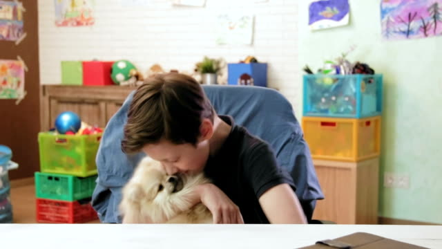 Cute little boy playing with his little dog showing his love video