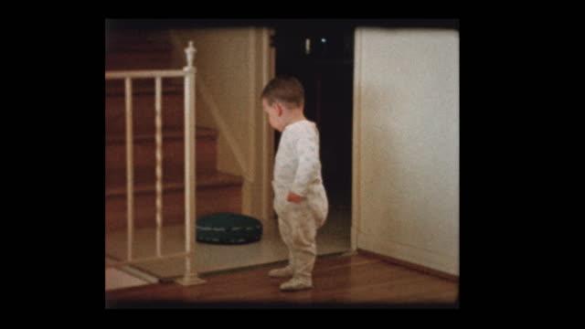 cute little boy toddler climbs steps - hotel reception filmów i materiałów b-roll