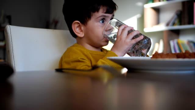 Cute little boy water