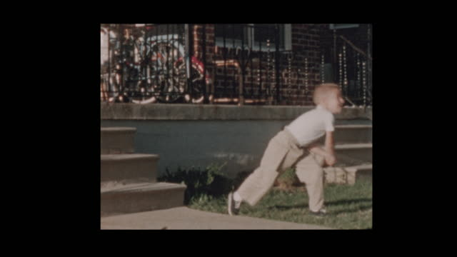 1956 Cute little boy with baseball bat swings at pitches video