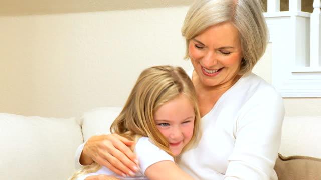 Cute Little Girl Being Hugged by Grandma video