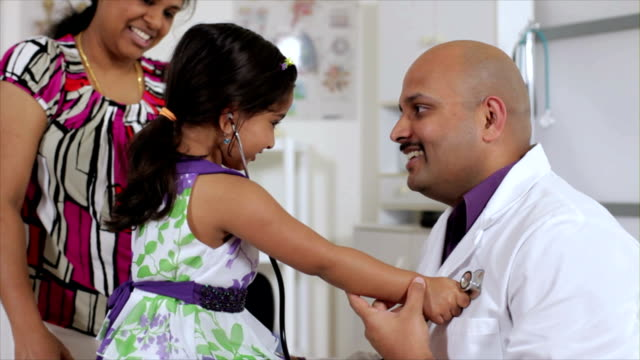 cute little girl checking the doctors heart video