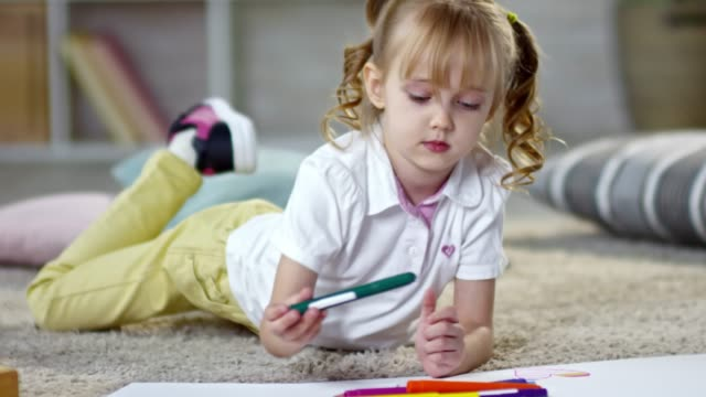 Cute Little Girl Drawing on the Floor video
