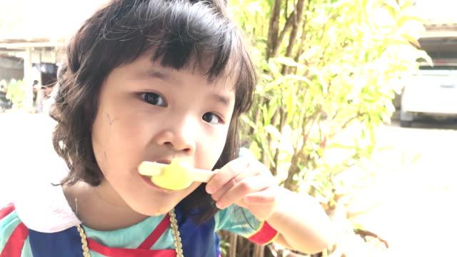 Cute little girl eating ice cream video