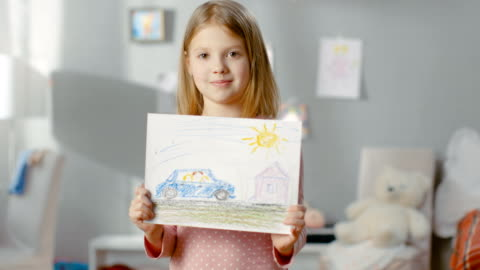 Cute Little Girl in Her Room Shows Drawing of Her Family in a Car. Cute Little Girl in Her Room Shows Drawing of Her Family in a Car. Shot on RED EPIC-W 8K Helium Cinema Camera. art and craft stock videos & royalty-free footage