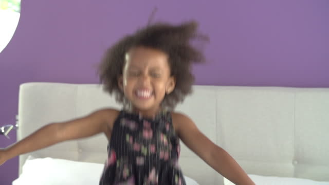 Cute Little Girl Jumping On Parent's Bed video