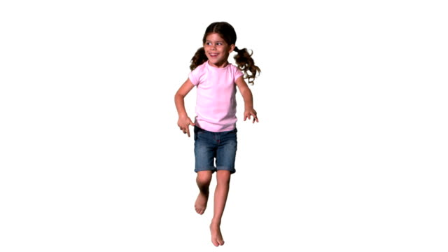 Cute little girl jumping on white background Cute little girl jumping on white background in slow motion pigtails stock videos & royalty-free footage